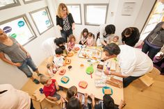 """Skirball's Executive Chef, """"Chef Sean,"""" leads participants of this Toddler Time session in a cooking project."""