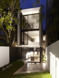 """Residential Architecture: Tusculum Residence by Smart Design Studio: """"..a contemporary renovation and extension for an early 20th-century terrace house..focuses on a grand and gracefully spiralling stair that forms the pivotal junction of the old and new parts of the house. The staircase, spanning the width of the building, features delicate fan-like steel treads cantilevered from the central steel post and winding their way past six split levels, offset between the old and new sides of the hous"""