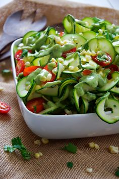 Fresh sweet corn, juicy cherry tomatoes and spiraled zucchini noodles are mixed & topped with a three ingredient dressing of creamy avocado dressing.