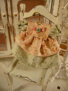 Miniature dollhouse baby dress.