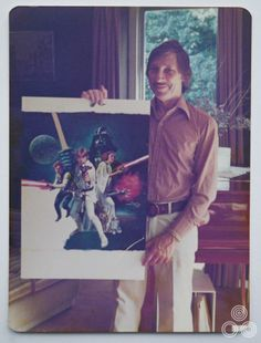 Tom Chantrell holding his almost finished artwork for Star Wars, early 1977