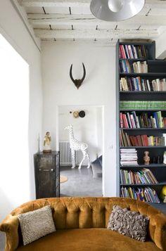 couch, bookshelves, white walls