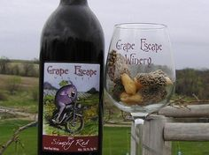 Grape Escape Vineyard & Winery Inc.  - Pleasantville, Iowa. Family-operated vineyard and winery. Wines are produced 100% from grapes grown in Iowa. Marion County's first winery.