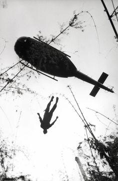 Man falling from WW2 helicopter. http://www.dazeddigital.com/fashion/article/16094/1/christopher-raeburn-on-camouflage