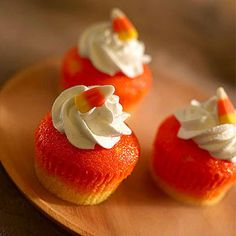 Candy Corn Cupcakes: Whipped cream forms the final layer of a tricolored treat inspired by the quintessential Halloween candy.