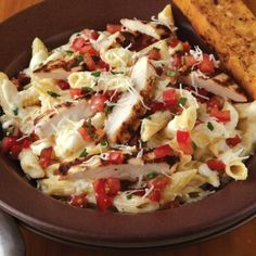 Three Cheese Chicken Penne Pasta 2 boneless skinless chicken breasts Italian salad dressing penne pasta jar of Alfedo sauce bag of shredded Italian cheeses 4 tomatoes 6-8 basil leaves 2-3 cloves of garlic 6 tablespoons extra virgin olive oil