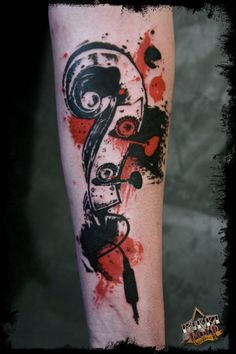 A double bass / Bass clef / Jack Cable Tattoo done by Mikki Bold (France).