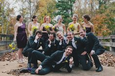 Another funny wedding photo idea of groomsmen posing as exaggerated bridesmaid poses