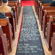 aisle runner with bible verse.  A great idea for a prayer station. Participants could write their own prayers here, or you could write prayers that have been offered through the weekend or through the year.