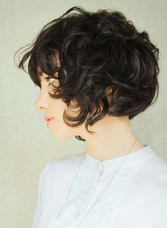 short curl. brunette.