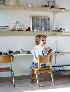 Create a desk/workspace for your child with low shelves.