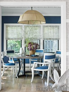 In the dining room, Buckley Royal linen upholstery softens both the walls and the Greek Peak chairs. Design: Thom Filicia. #blue #dining_room