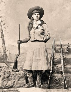 Annie Oakley, who earned worldwide notoriety for her shootist skills while touring with Buffalo Bill's Wild West, holds a Stevens tip-up target rifle and displays three of her arena guns—a double-barreled shotgun, a Spencer slide-action shotgun and a long-barreled Stevens pistol—in this circa 1886 cabinet card.  – Courtesy Heritage Auctions, December 11-12, 2012 –