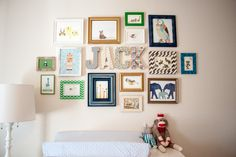 We love the mix of colors, patterns and sizes in this #nursery #gallerywall!