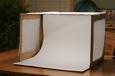 Learn how to make a DIY light box to help photograph your crafts. This box will make your images looks brighter and can eliminate shadows all around for photos that really pop.