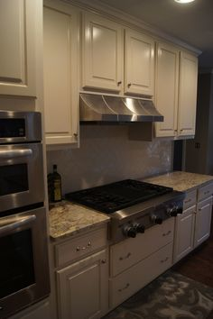 Original Oak cabinets refinished to a custom off-white finish with ...