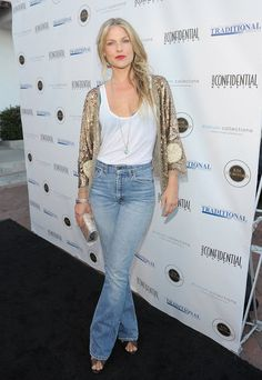 Ali Larter went the boho-glam route, pairing her flares with a gold-tinged kimono jacket.