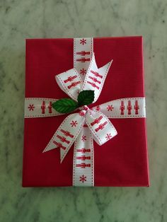 Sweet look—red Christmas gift wrap & ribbon with an embellishment
