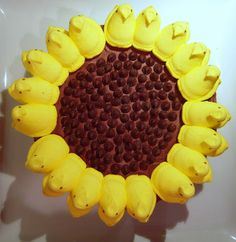 Whats up Peeps!  Sunflower cake-made this for Easter dinner, but used almond slivers instead of the chocolate chips for the center...my peeps didn't round out nice but was more square, but turned out cute anyway