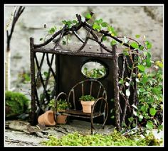 Fairy Garden Shelter - LOVE this, bent metal back/top, trimmed out in twig frame, the chair looks like it could be made of soldered wire - gorgeous piece!   ********************************************  FoxSpecialty - #fairy #garden #gardens #miniature #miniatures #fairies #whimsical #whimsy #shelter #chair - tå√