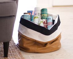 Adventures in salvage: a slouchy storage bin made from recycled couch leather. #DIY