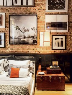 Exposed brick with a black and white photo wall