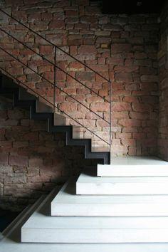 Architekturbüro Jürgen Mayer folding steel outline zig zag concrete plinth landing exposed brick wall