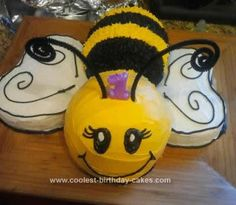 """Homemade Bumble Bee Cake: Our baby girl's name is Isabel, but we cal her """"Busy Bee."""" Naturally, her first cake had to be... a bee!! I used the Wilton Sports Ball cake pan for the"""