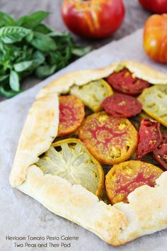 [what a perfectly good way to use these beautiful tomatoes!] Heirloom Tomato Pesto Galette from @Maria (Two Peas and Their Pod)
