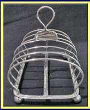 Antique English, Georgian Sterling silver 6-slice large toast rack made in London, England, by Chas Fox in 1833.   The toaster is the epitomy of elegant simplicity and looks as wonderful today as it did almost 200 years ago. $600.00