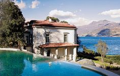 view of white house & sea from the pool in Como, Italy