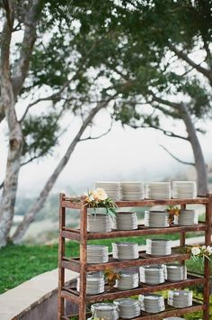 Rustic wooden Cobble Shoe Shelf from Found Vintage Rentals used in wedding reception buffet