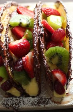 nutella fruit dessert tacos / not sure i would use real taco shells, more like make sugar cookie and fold it into a taco shape