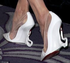 On her toes: The eye-catching shoes are certainly spooky like Ms Jolie's character; the white pair even had drips of red on the tips of the horns that looked like blood
