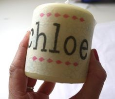 Draw on wax paper with a permanent marker. Wrap the paper around a candle, and light the candle. Once the candle is heated enough, the drawing will be transferred to the candle.