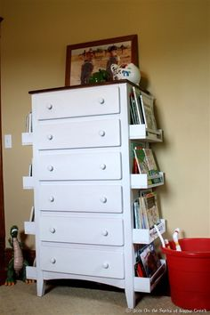 Attach Ikea Spice Racks to sides of Dresser for Book Storage! Fantastic idea!