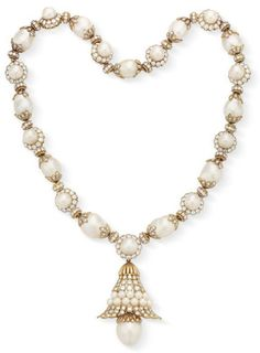 Suspending a detachable circular-cut diamond and cultured pearl openwork foliate pendant, to the neckchain designed as a series of cultured pearls, within circular-cut diamond surrounds and baroque cultured pearls, with circular-cut diamond caps, mounted in 18k gold, 20. 1/4 ins., may also be worn as a bracelet of 7 ins., in a Van Cleef & Arpels gray suede envelope case Signed V.C.A. for Van Cleef & Arpels, N.Y., no. 40277 (est. $30,000 - 50,000)