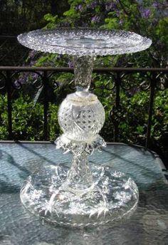 Glass bird feeder or birdbath