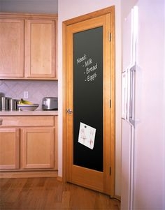 Another genius chalkboard idea--possibly on the back of a pantry door? I love it.
