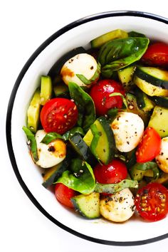 This Caprese Cucumber Salad recipe is quick and easy to make with 5 main ingredients -- fresh cucumber, tomato, basil, mozzarella and an easy balsamic glaze. Feel free to stir in some pasta if you'd like, too, to make a pasta salad! | Gimme Some Oven #caprese #cucumber #salad #pastasalad #summer #dinner #recipe