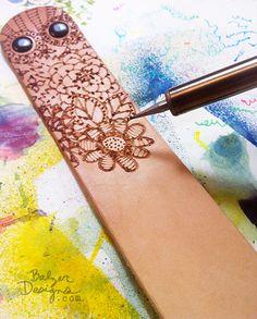 pen, leather cuffs, design blog