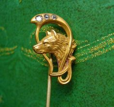 A true antique treasure this rare and wonderful wolf or dog stickpin has paste rhinestones that frame his head. The Victorians were known for their mythical and unusual creatures in their jewelry. The...
