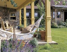Lovely yellow porch with hammock.