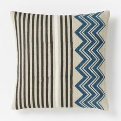 NEW! Handcrafted by Eco Tasar, a sustainable silk cooperative in rural India, these handspun silk pillows are block printed in a chevron and horizontal stripe pattern.