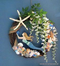 Here is a large mermaid wreath, a 24 inch mermaid wreath with starfish and seashells along with pretty florals and greenery. I glitzed up