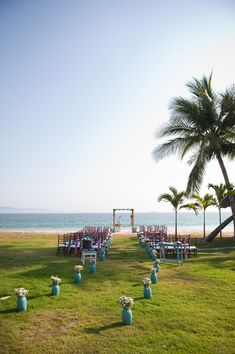 Beach Wedding - Aisle created by Vases of Flowers -- See more on SMP, here: http://www.StyleMePretty.com/destination-weddings/2014/05/28/beach-chic-punta-mita-wedding-at-casa-amore/ Photography: KLKPhotography.com - Wedding Planning: TheDazzlingDetails.com