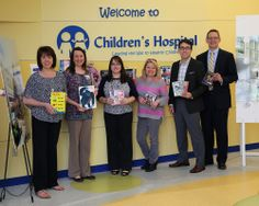 Employees from DeRoyal made a delivery of 491 in-kind items (toys, DVDs, infant blankets and caps, toiletries, coloring books, crayons, and restaurant gift cards). They also made a large cash donation to the hospital. gift card, crayon, infant blanket