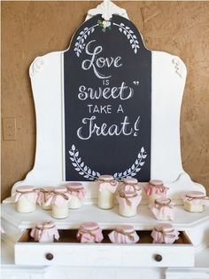 Love is sweet. Take a treat. White lettering against black background.