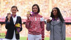 Silver medallist Lashinda Demus (R) of the United States, gold medallist Natalya Antyukh (C) of Russia and bronze medallist Zuzana Hejnova (L) of Czech Republic pose on the podium during the Medal Ceremony for the women's 400m Hurdles