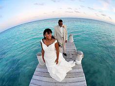 Such a cool wedding photo on the pier. Hoffmann Photographer.